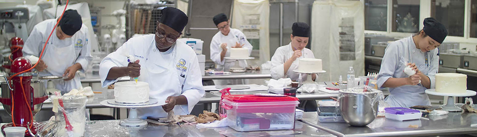 Culinary Arts students preparing cakes