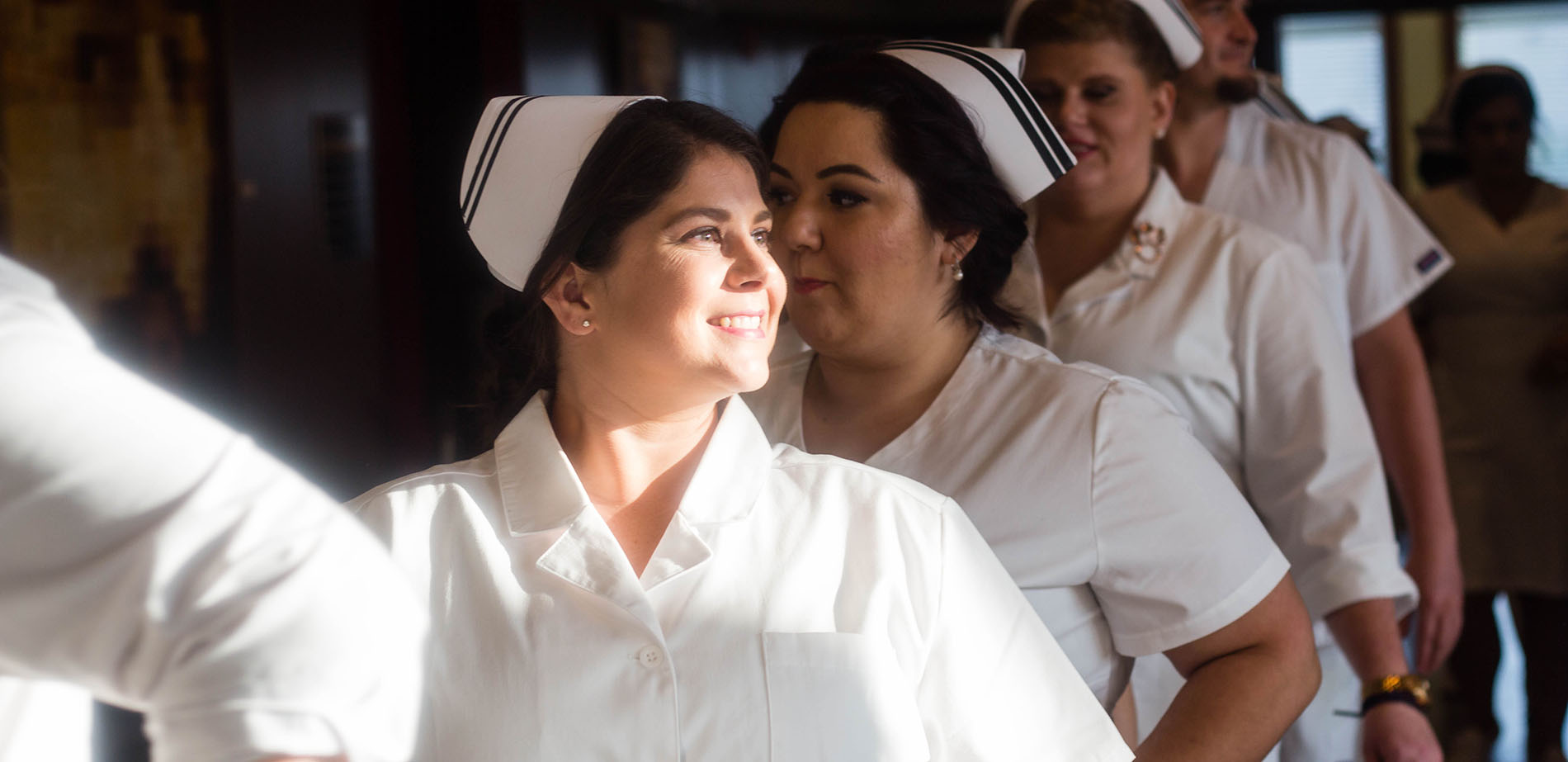 Nursing students in traditional white uniforms