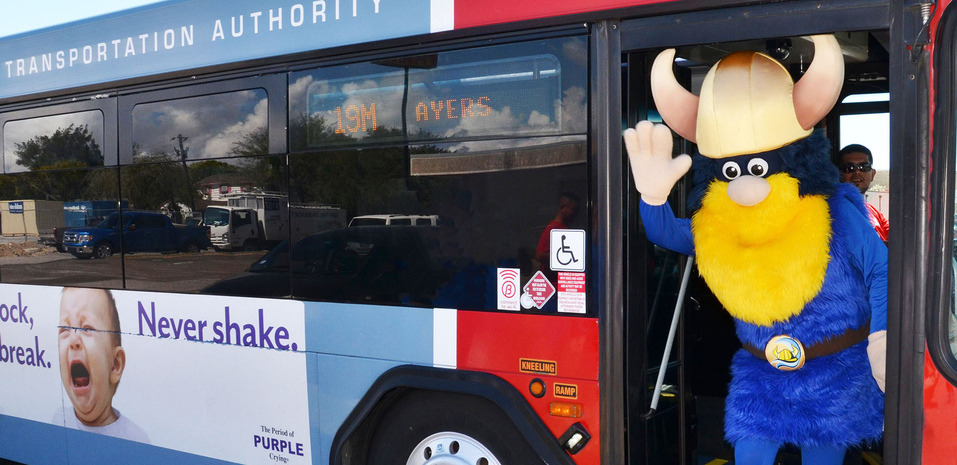 Valdar the Viking mascot steps off from an RTA bus