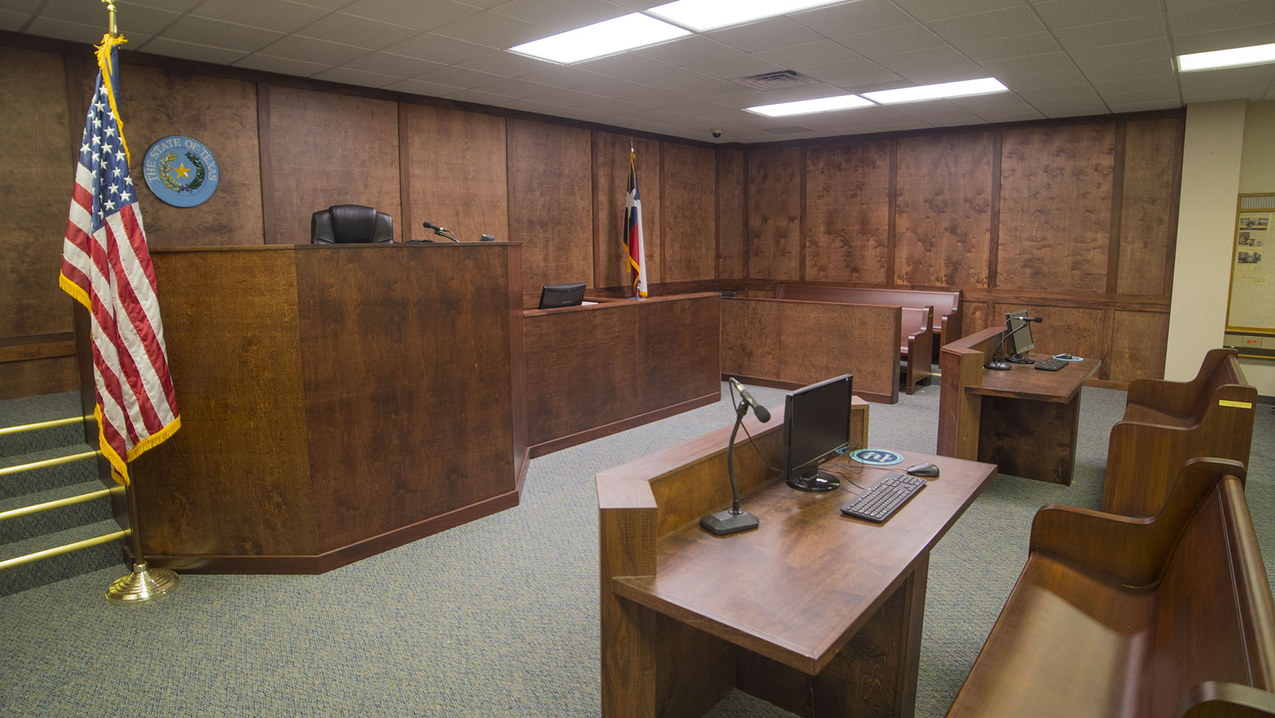 Students inside the courtroom like classroom reenacting a court case
